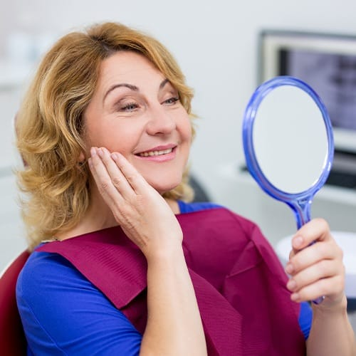 Woman looking at smile after smile makeover