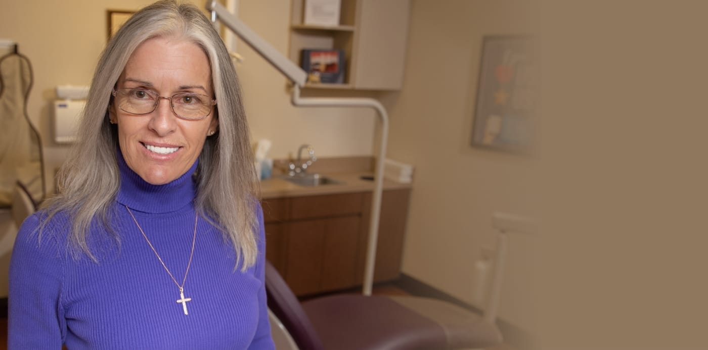 Dental patient Joanne K smiling after full mouth reconstruction