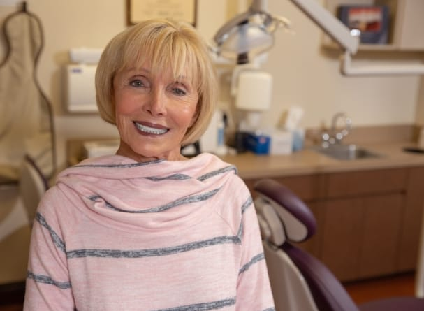 Dental patient with new denture smiling