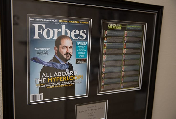 Cover of Forbes Magazine featuring dental office